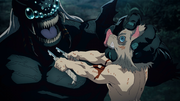 Inosuke stabbing the Father Spider Demon