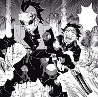 Genya shields Tanjiro from Aizetsu's Blood Demon Art CH115