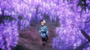 Tanjiro walking among the Wisterias