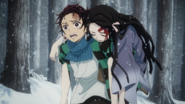 Tanjiro carrying a wounded Nezuko