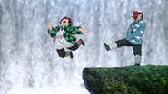 Sakonji kicking Tanjiro off the mountain