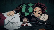 Tanjiro placing his hands on dying Rui