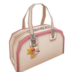 Un llavero de Moguri en el bolso de <a href=