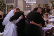 Doug and Carrie embrace bride and groom Todd