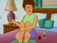 Peggy coloring her Toenails
