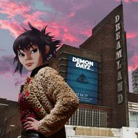 Noodle in front of the Demon Dayz building