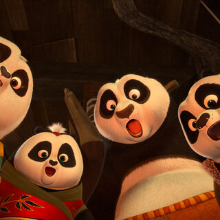 The panda kids using their chi to reveal a hidden message on a scroll