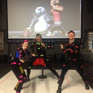Crew members filming in motion-capture suits