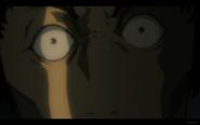 Okata's Eyes Widen in Fear
