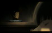 Kuro's Head Sits on a Stone Slab