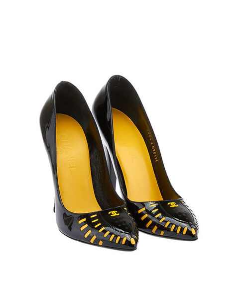 File:Black patent with a yellow Chanel logo pumps.jpg