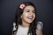 Marta+Hewson-portrait-+little+girl+dark+with+flower+in+hair
