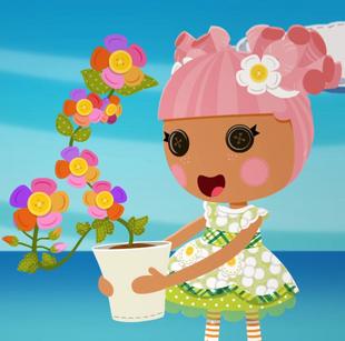"""Blossom sosteniendo la planta """"Una día"""" completamente desarrollada."""