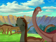 Eating Camarasaurus with really long tailed red backed sauropod in BG