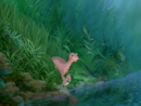 Littlefoot guides his grandparents and other grown-ups to the new water he discovered