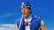 Sportacus blowing the ping pong racket
