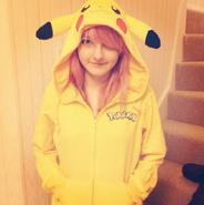 Lizzie in a pikachu onesie