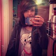 Lizzie with dark hair.