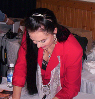 File:Crysal Gayle signing autographs.PNG