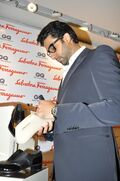 Nfyn71f6rhrmea6r.D.0.Abhishek-Bachchan-signing-his-autograph-on-the-special-shoe-at-the-launch-of-Salvatore-Ferragamo-project-Shoes-for-a-Star-in-Mumbai