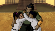 Ang and Ling Hugging Their Father