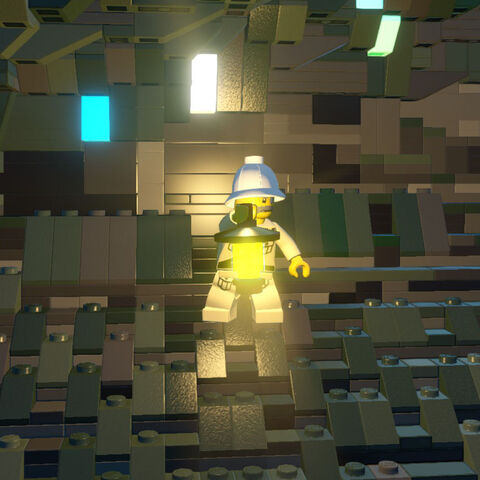 Explorer with a lantern in a cave.