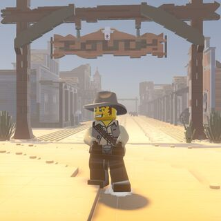 Cowboy under the Frontier Town sign.