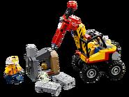 60185 L'excavatrice avec marteau-piqueur