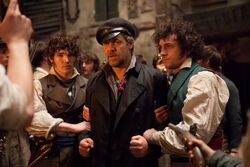 Courfeyrac, Javert, and one of the other volunteers