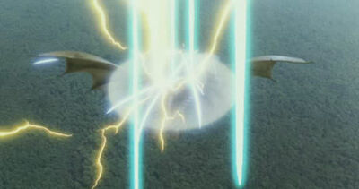 Grand King Ghidorah's force barrier repelling Mothra's Sparkling Rainbow Buster