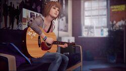 Max tocando violão