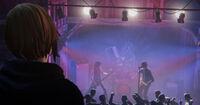 Chloe watching Firewalk at the Punk Club