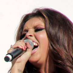 "Jesy Neslon's wrist tattoo is the roman numeral number ""IX•VIII•XI"" which is ""9•8•11″"