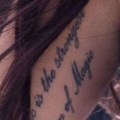 "On the inside of her upper right arm are the words ""Music is the strongest form of magic"""