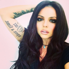 Jesy's feather and eye tattoo on her left forearm