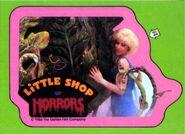 Little Shop of Horrors Topps Sticker - Audrey hugs Audrey II
