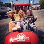 Cast and crew on go cart