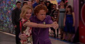 Liv smiles at Artie's tango skills