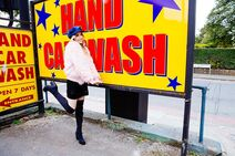 LIZ in front of a car wash sign