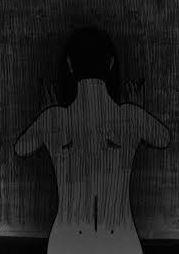 File:Woman facing the wall.JPG