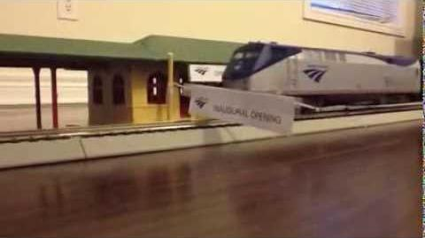 "Train ""cuts"" ribbon, then departs"