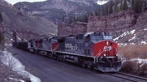 39600 of GE AC horse power, lifts a train toward DRG&W's Tennessee Pass at Pando, CO. 1997