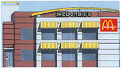 2 story McDonald's building with the 1996 eyebrow exterior design