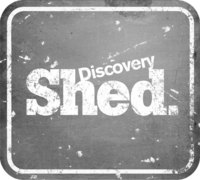Discovery Shed logo distressed silver
