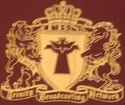 TBN Crest in red book