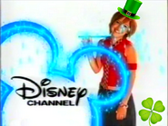Lalaine wearing a Saint Patricks hat and with a four leaf clover