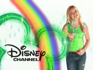 Hilary Duff wearing green clothing and with a rainbow