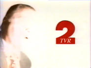 TVR 2 man in suit ad id 2