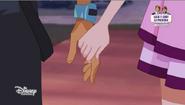 Iris and Nathaniel holding hands - Raffle Baffle