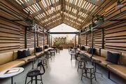 Beautiful-Restaurant-Dining-Area-with-Wooden-Walls-and-Ceiling-e1433076544755